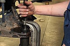 Mechanic working on a vehicle at Amtech Auto Care Inc. - image #3