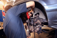 Mechanic working on a vehicle at Amtech Auto Care Inc. - image #10