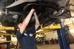 Mechanic working on a vehicle at Amtech Auto Care Inc. - image #6