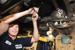 Mechanic working on a vehicle at Amtech Auto Care Inc. - image #11