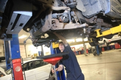 Mechanic working on a vehicle at Amtech Auto Care Inc. - image #7